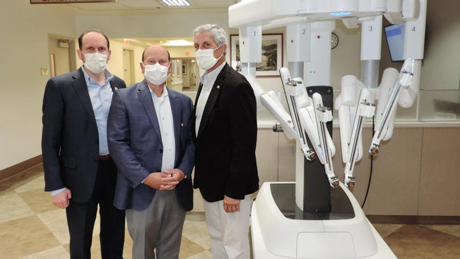 Dameron Hospital President Daniel Wolcott, from left, board member Brian Martucci and board president Bill Trezza show off the hospital's new da Vinci Xi Surgical Robot.