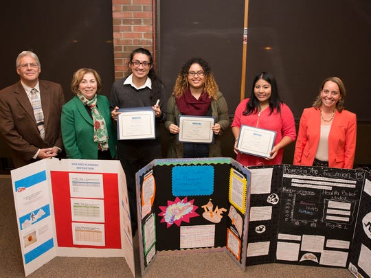 From left: Professor Albert Joy, whose Student Success classes yielded all three winners; Joann La Perla-Morales, College president; Humberto Marmolejo of Carteret, first place winner whose poster focused on how motivation related to academic success; Ashley Abreu of Perth Amboy, second place winner whose poster looked at time management and correlations with performance and stress; Crysol Lopez-Perez of North Brunswick, whose poster highlighted how entering college affects weight gain and overall health; and Dr. Harrington. Humberto Marmolejo was awarded $1,500; Ashley Abreu $800 and  Crysol Lopez-Perez $500.