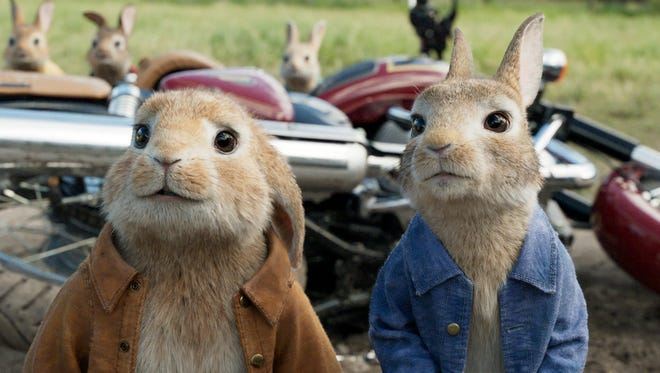 """This image released by Columbia Pictures shows characters Benjamin, voiced by Colin Moody, left, and Peter Rabbit, voiced by James Corden and Cottontail in a scene from """"Peter Rabbit."""" (Columbia Pictures/Sony via AP)"""