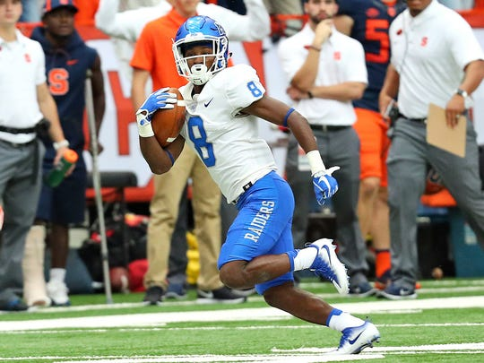 MTSU wide receiver Ty Lee runs the ball in a game against Syracuse at the Carrier Dome on Sept. 9, 2017.