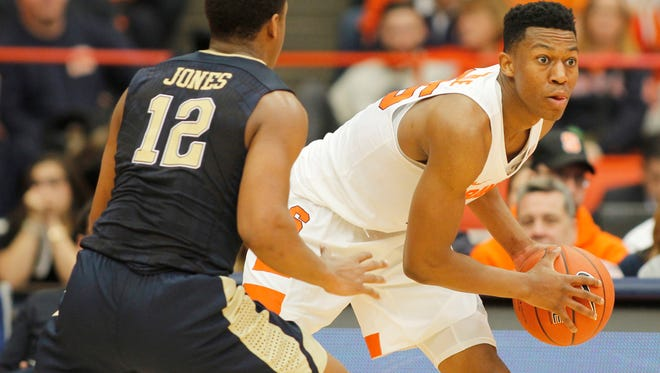 Syracuse's Tyus Battle, right, looks to pass the ball against Pitt.