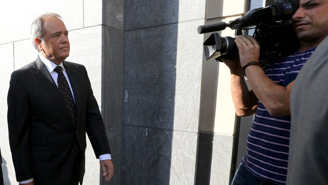 Jonnie Williams, left, former chief executive of Virginia-based Star Scientific, heads July 31, 2014, into the federal courthouse in Richmond, Va., for the corruption trial of former Gov. Bob McDonnell and his wife.