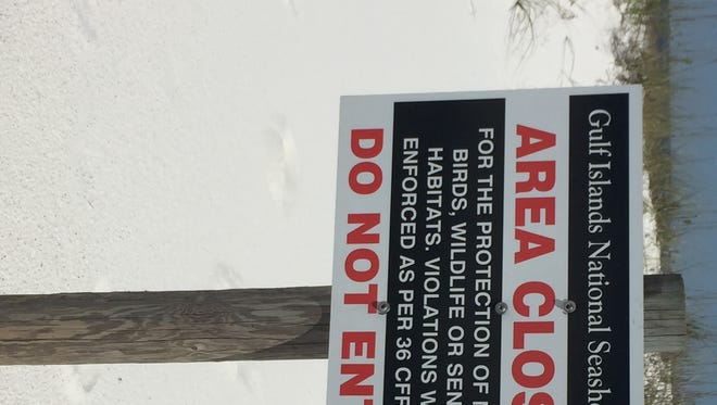 A sign posted near a shorebird nesting area at Gulf Islands National Seashore on Monday.