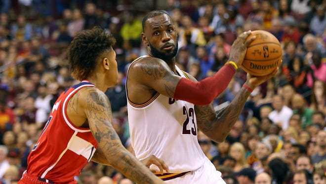 Oct 18, 2016; Columbus, OH, USA; Cleveland Cavaliers forward LeBron James (23) controls the ball against Washington Wizards forward Kelly Oubre Jr. (12) in the second half at the Jerome Schottenstein Center. The Wizards won 96-91. Mandatory Credit: Aaron Doster-USA TODAY Sports