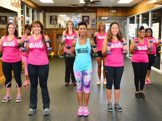 Nicole Randolph leads the group in hammer curl exercises.