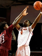 Troy's Jordon Varnado (left) is averaging 15.4 points and 7.0 rebounds per game this season for the Trojans.