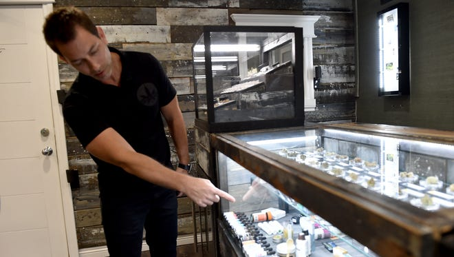 Aaron Justis, president of Buds & Roses in Studio City, explains the various cannabis-based products available at his Studio City dispensary. The Ventura County supervisors will consider a proposal Tuesday that would ban marijuana businesses in the unincorporated portions of the county.