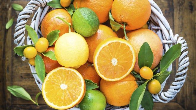 Mixed basket of fresh citrus.