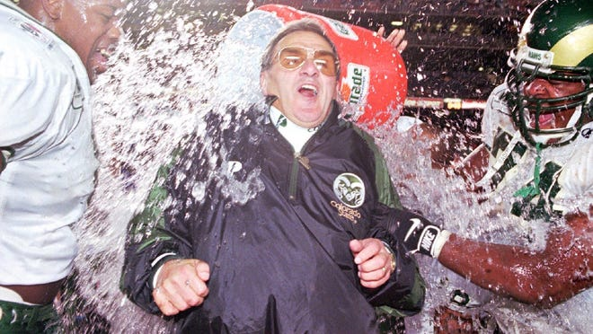 Former CSU head coach Sonny Lubick gets Gatorade dumped on him by his players at the end of the 1997 Holiday Bowl in San Diego against Missouri. Where to the '97 Rams rank among the all-time best CSU teams?