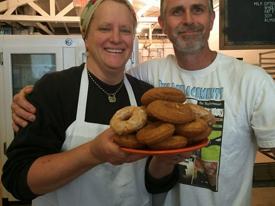 General American Donut Co. owners Adam Perry and his wife, Kari Nickander, hold a plate of the original Salvation Army Doughnut Girls rounds as well as a couple glazed versions of the doughnut. The 827 S. East St. shop at the Fletcher Place/Holy Rosary serves the doughnuts as a Veterans Day special Nov. 9-11.