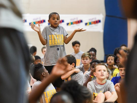 Nine-year-old Omari Dennis asks a question during a Q&A at the 7th annual Trevor Booker Basketball Camp in Mauldin Friday, June 15, 2018.