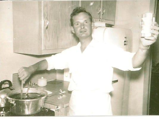 Dad stirring spaghetti sauce