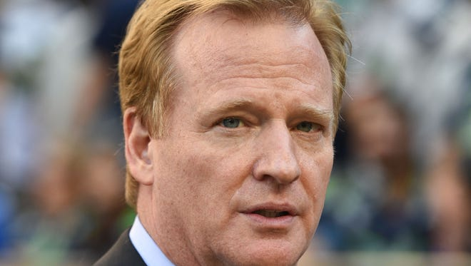 NFL commissioner Roger Goodell walks the sidelines before the game between the Seattle Seahawks and the Green Bay Packers at CenturyLink Field.