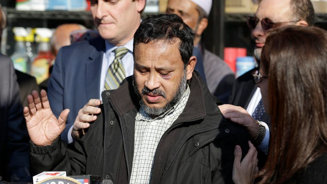 Local politicians and community leaders put their hands on Sarker Haque as he becomes emotional during a news conference in New York, Thursday, Dec. 10, 2015. Haque, who is a Muslim, was attacked in his store and the police are investigating the incident as a hate crime.  Advocacy groups believe there has been a spike in anti-Muslim incidents across the United States in recent weeks that can be linked to last week's mass shooting in California and the inflammatory rhetoric of Donald Trump and other Republican presidential candidates. And they say that Muslims are fearful the backlash could lead to further harassment and violence.