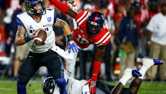 October 1, 2016 - University of Memphis quarterback Riley Ferguson (left) scrambles away from Ole Miss defender Marquis Haynes (right) during fourth quarter action at VaughtÐHemingway Stadium in Oxford, Miss.(Mark Weber/The Commercial Appeal)