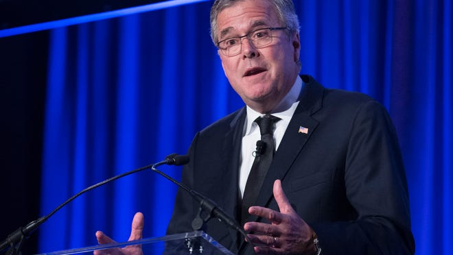 Former Florida Gov. Jeb Bush speaks at the Manhattan Institute for Policy Research Alexander Hamilton Award Dinner, Monday, May 12, 2014, in New York. Bush and Rep. Paul Ryan, R-Wis., courted some of Wall Streetís most powerful political donors Monday night, competing for attention from tuxedoed hedge fund executives gathered in midtown Manhattan as the early jockeying in the 2016 presidential contest quietly continues. (AP Photo/John Minchillo) ORG XMIT: NYJM117