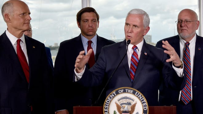 Vice President Mike Pence, center, along with Florida Sen. Rick Scott, far left, and Gov. Ron DeSantis, left, and CDC Director Dr. Robert Redfield, right, speaks to the media after a meeting with cruise line company leaders to discuss the efforts to fight the spread of the COVID-19 coronavirus, at Port Everglades, Saturday March 7, 2020, in Fort Lauderdale, Fla.