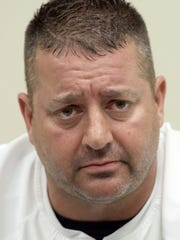 York Catholic head football coach Eric DePew.