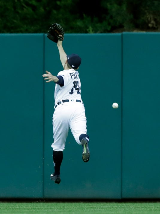 Detroit Tigers center fielder Alex Presley misplays the double by Los Angeles Angels' Yunel Escobar during the fourth inning of a baseball game, Tuesday, June 6, 2017, in Detroit. (AP Photo/Carlos Osorio)