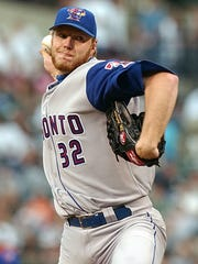 Roy Halladay pitches for the Toronto Blue Jays against