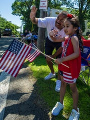 (L-R) Dad Tobe Dussinger of Mine Hill and daughter Samantha, 5, at the Annual Randolph Kiwanis Freedom Festival Parade in Randolph, June 30, 2018.  Photo by Warren Westura for the Daily Record.