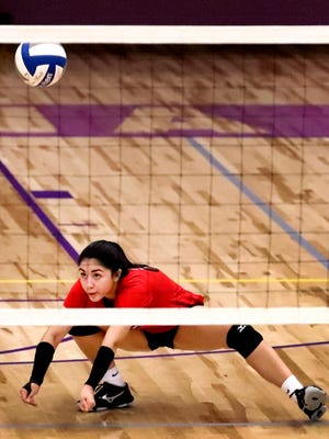 Stewarts Creek's Coralys Colon dives for a dig during a match Wednesday at Smyrna.