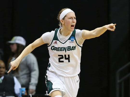 UWGB's Allie LeClaire points to her teammates after hitting a 3-pointer during the second half against Minnesota in an NCAA first-round game in Eugene, Ore.