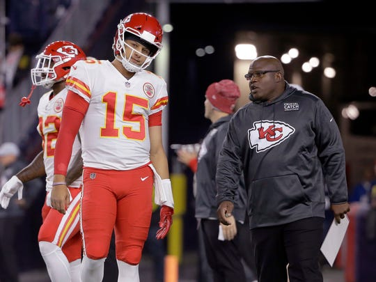 NY Giants head coaching candidate Eric Bieniemy, the current offensive coordinator in Kansas City, talks to quarterback Patrick Mahomes.