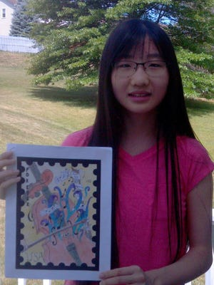 Amy Ruan holds her first-prize-winning entry in the Rochester Philatelic Association's Design-a-Stamp contest.