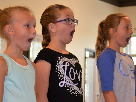 Members of the In Motion Dance Studio in Plymouth practice making faces during a facial expressions workshop Oct. 15 by local native and professional actor Tim Stoltenberg (not pictured).