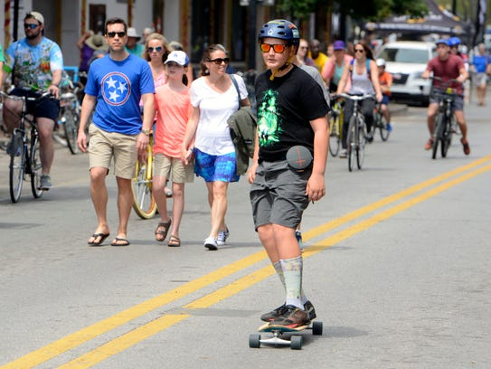 People play games, walk, bike and skateboard the streets