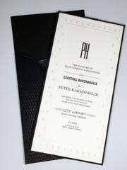 This is a photo of an invitation to a party to be held in honor of Peter Karmanos Jr. in 2013.