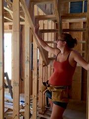 New homeowner Kelda Harrison shows off the stairs she