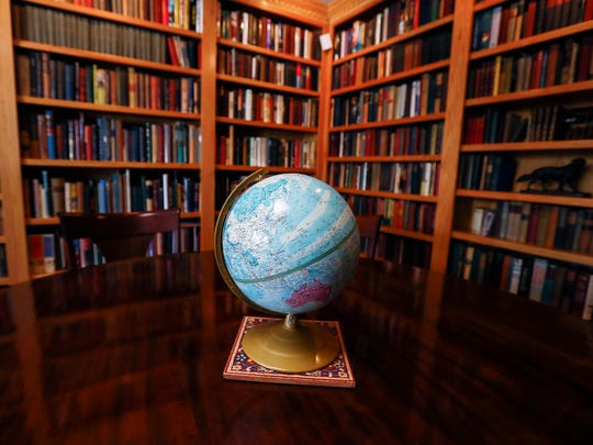 A huge library is a feature of the home for sale at