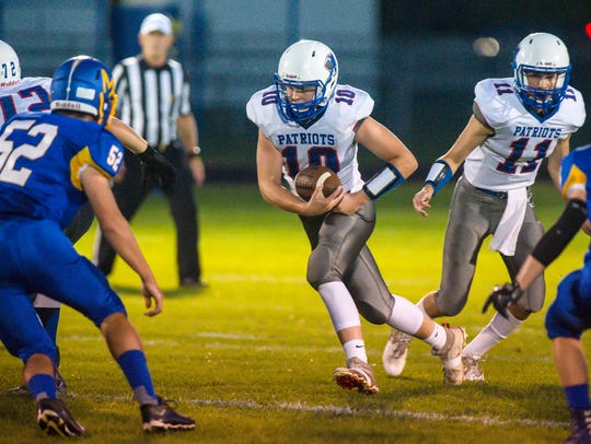 Mt. Anthony's Carson Morgan looks for room to run against