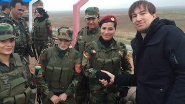 Adam Sulkowski with female Peshmerga soldiers in Kurdistan in January 2016.
