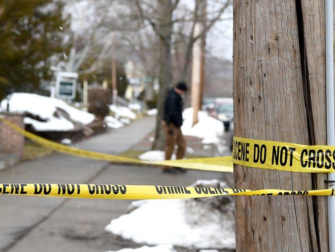 Law enforcement officials investigate a crime scene