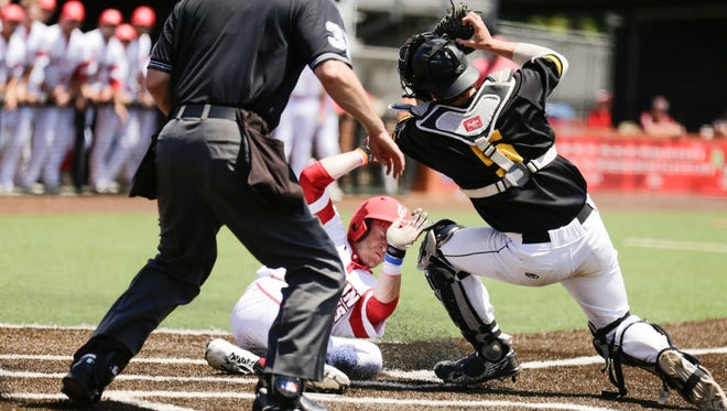 UL's Kyle Clement slides home under Appalachian State catcher Chandler Seagle with what stood up as the game-winning run off a Joe Robbins suicide squeeze in a 4-1 victory Sunday at The Tigue.