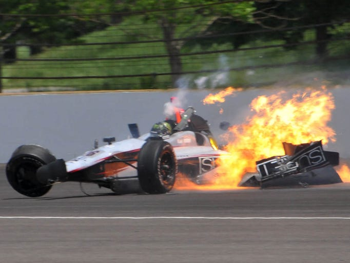NASCAR regular, Kurt Busch crashing in turn two during practice for Sunday's Indianapolis 500 Mile Race , Monday   May 19,  2014  at The Indianapolis Motor Speedway. Busch was unhurt in the crash.