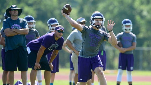 Mitchell quarterback Ben Young throws a pass during