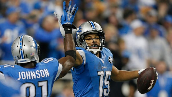 Detroit Lions Calvin Johnson gives a high five to Golden