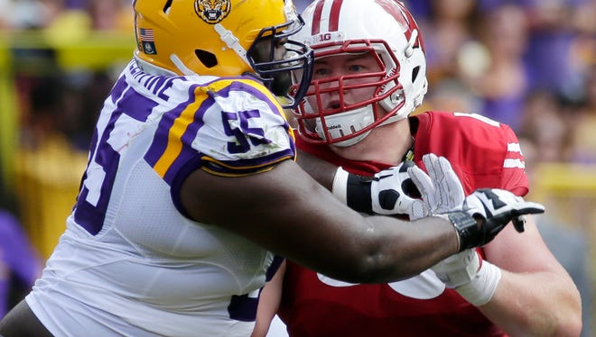 UW junior Michael Deiter, blocking LSU nose tackle Travonte Valentine last season, is working diligently in camp to hone his craft at left tackle after starting a combined 27 games at center and left guard in his first two seasons.