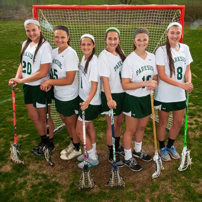 Parkside seniors Kelsey (11) and Alexis (12) Nock are just one set of siblings taking the field for the Rams girls lacrosse team this spring.