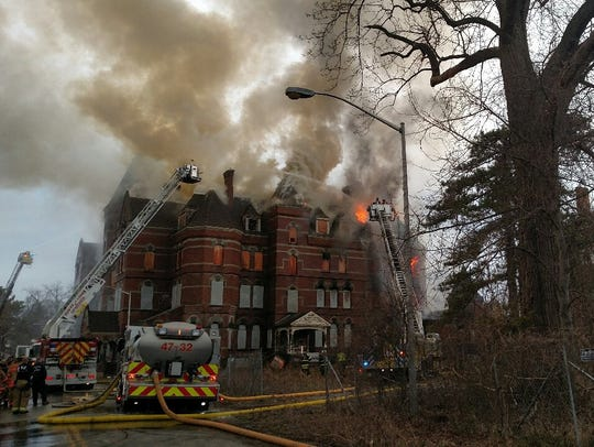 Firefighters Friday battle a blaze at the former Hudson