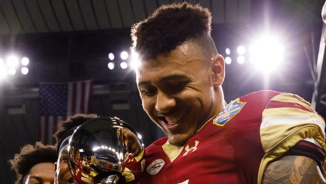 Dec 26, 2016; Detroit, MI, USA; Boston College defensive end Harold Landry holds the championship trophy after defeating Maryland in the Quick Lane Bowl at Ford Field.