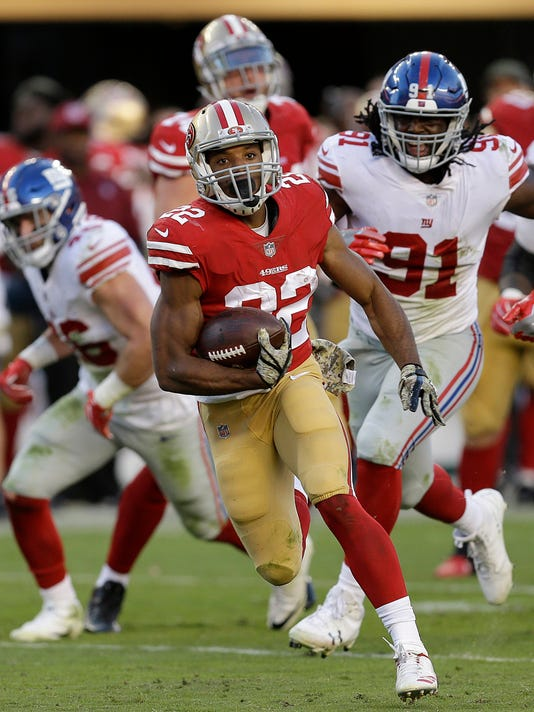San Francisco 49ers running back Matt Breida (22) runs for a touchdown against the New York Giants during the second half of an NFL football game in Santa Clara, Calif., Sunday, Nov. 12, 2017. (AP Photo/Ben Margot)