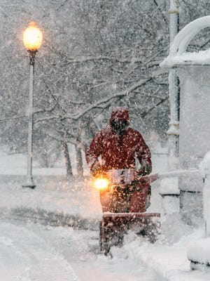 A snowblower operator cuts in to the heavy snow in Congress Park during a snow storm, Friday, March, 2 2018, Saratoga Springs, N.Y. A major nor'easter packing wet, heavy snow has sent tree limbs crashing down, left more than 150,000 customers without power and closed schools across upstate New York. (Skip Dickstein/The Albany Times Union via AP)