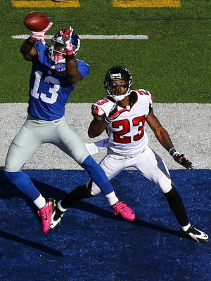 Giants wide receiver Odell Beckham scores a 15- yard touchdown in the fourth quarter against Falcons cornerback Robert Alford during their game Sunday at MetLife Stadium in East Rutherford, New Jersey.
