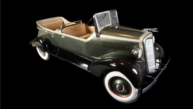 """This 1935s Lincoln dual cowl phaeton pedal car by American National Skippy is a custom 66"""" by 27"""" by 22"""" pedal car with upholstered interior, chrome accents and three-tone paint. Barrett-Jackson describes this one as """"exquisite."""""""