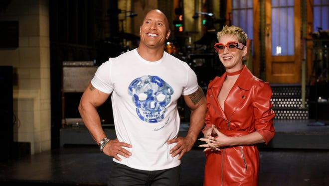 """SATURDAY NIGHT LIVE -- """"Dwayne Johnson"""" Episode 1725 -- Pictured: (l-r) Host Dwayne Johnson with musical guest Katy Perry in Studio 8H on May 17, 2017 -- (Photo by: Rosalind O'Connor/NBC)"""